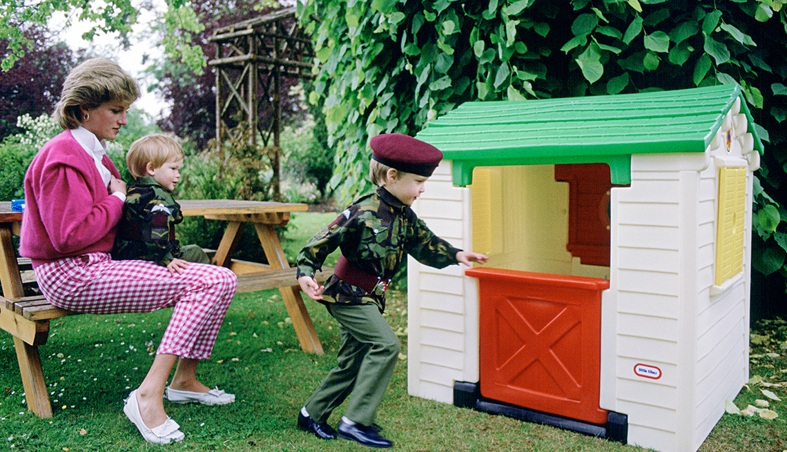 item 3 of Gallery image - Princess Diana With Her Sons Prince William And Prince Harry Playing With A Playhouse In The Garden Of Their Home Highgrove.