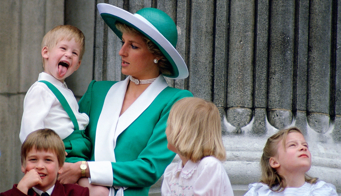 item 5 of Gallery image - Prince Harry Sticking His Tongue Out Much To The Suprise Of His Mother, Princess Diana At Trooping The Colour With Prince William, Lady Gabriella Windsor And Lady Rose Windsor Watching From The Balcony Of Buckingham Palace.