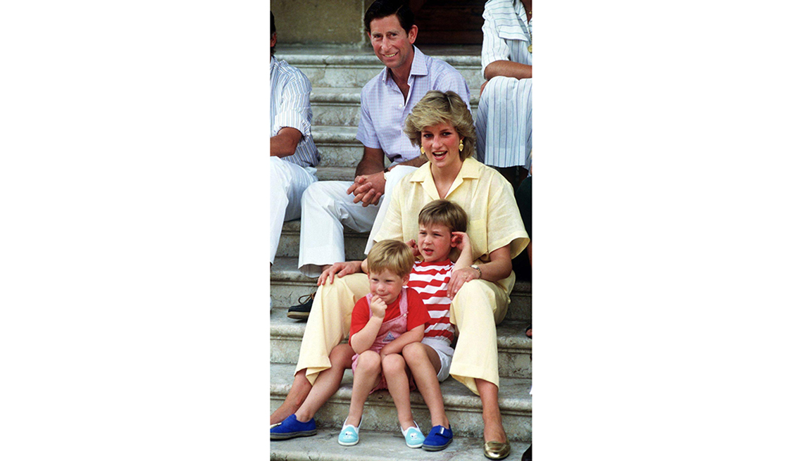 item 4 of Gallery image - The Prince and Princess of Wales on holiday with their children, Princes William and Harry, at the Spanish royal residence Marivent Palace, August 1987.