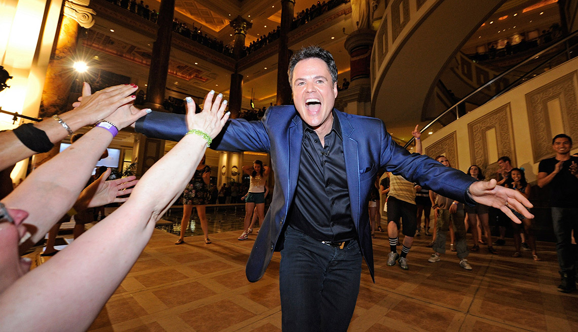 Actor Donny Osmond Greats A Crowd Of Fans, AARP Entertainment, How Celebrities Face Their Worst Fears