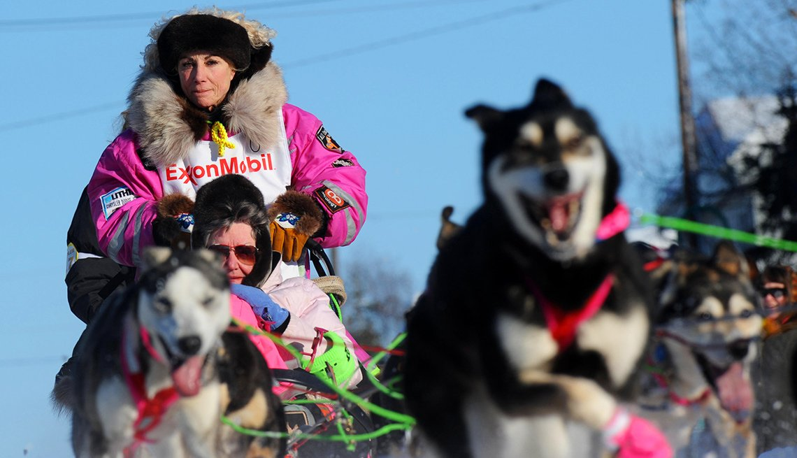 Iron lady iditarod musher DeeDee Jonrowe with her team