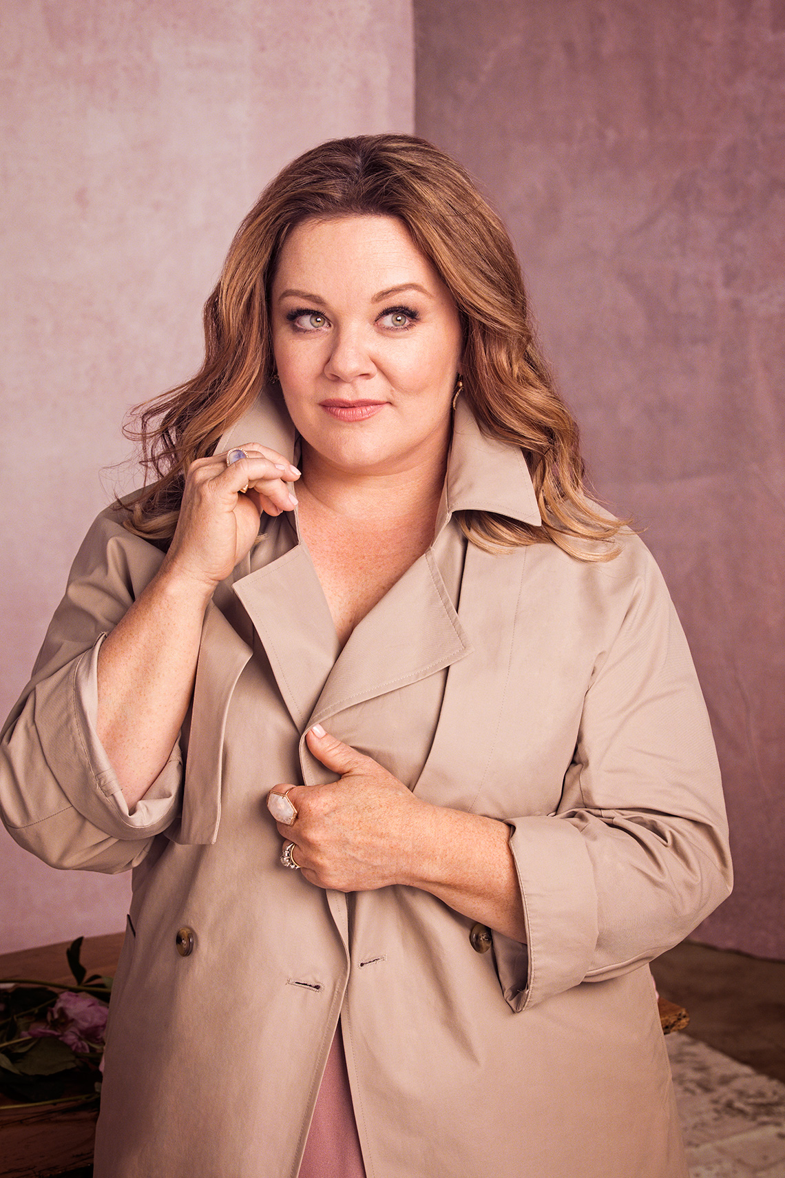 Melissa McCarthy dressed in a trenchcoat