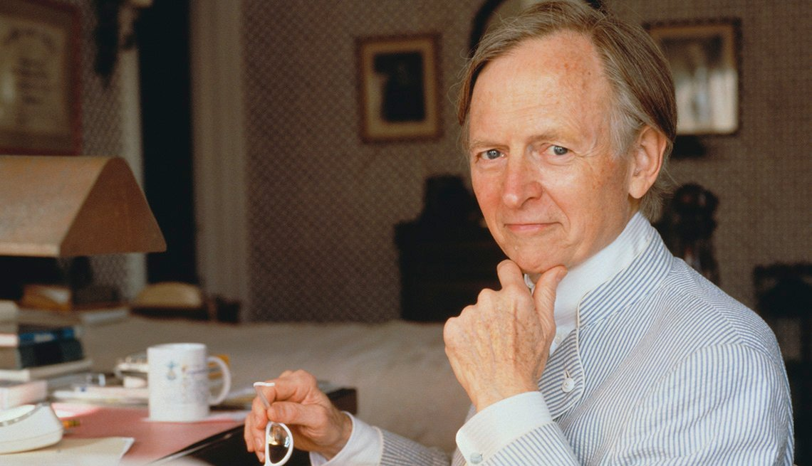 item 19 of Gallery image - Novelist Tom Wolfe seated at a desk
