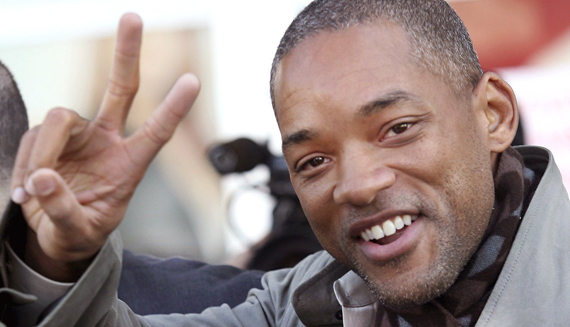 Actor Will Smith gives the peace sign