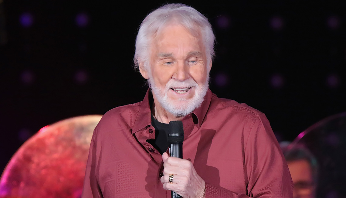 item 8 of Gallery image - Kenny Rogers holding a microphone.