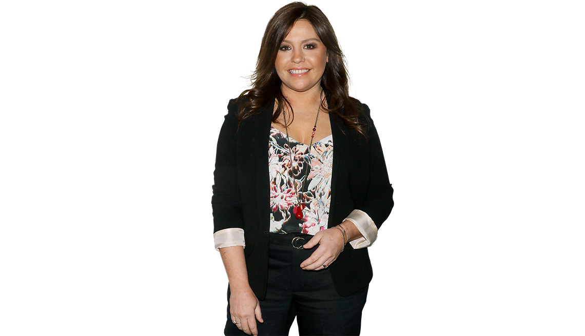 item 9 of Gallery image - Rachael Ray standing, dressed in black, with a printed top.