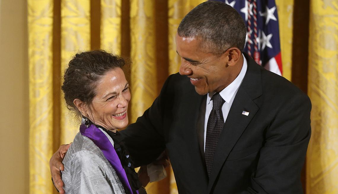 President Obama with an arm around Julia Alvarez.