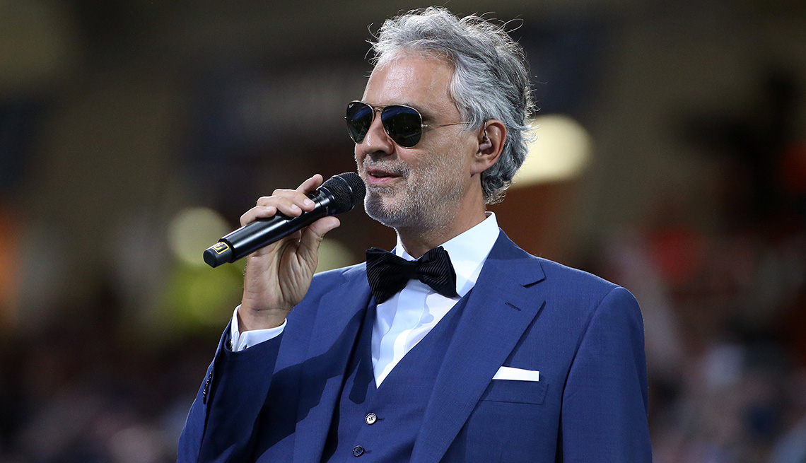 item 4 of Gallery image - Andrea Bocelli holding a microphone