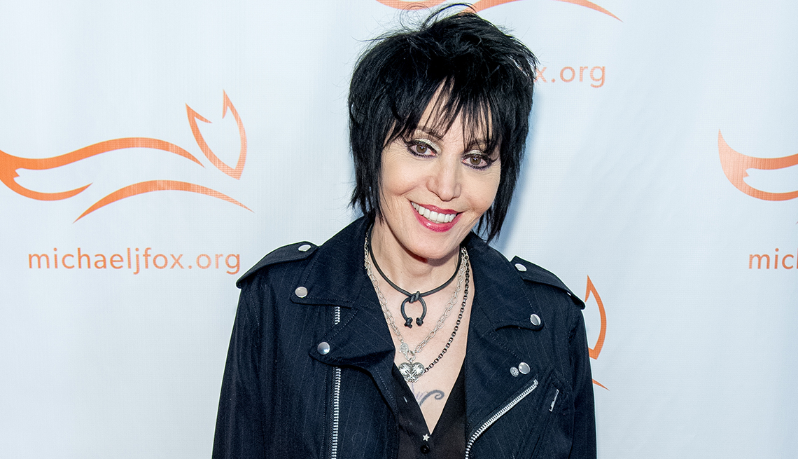 item 5 of Gallery image - Joan Jett smiling in front of a backdrop that reads michaelJfox.org