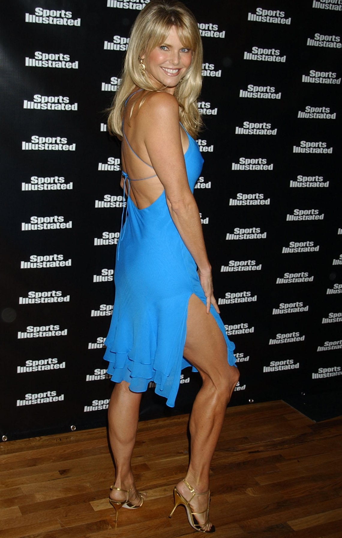 Christie Brinkley in front of a Sports Illustrated sign