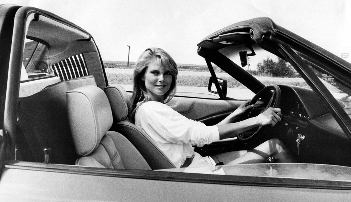 Christie Brinkley sitting in a convertible