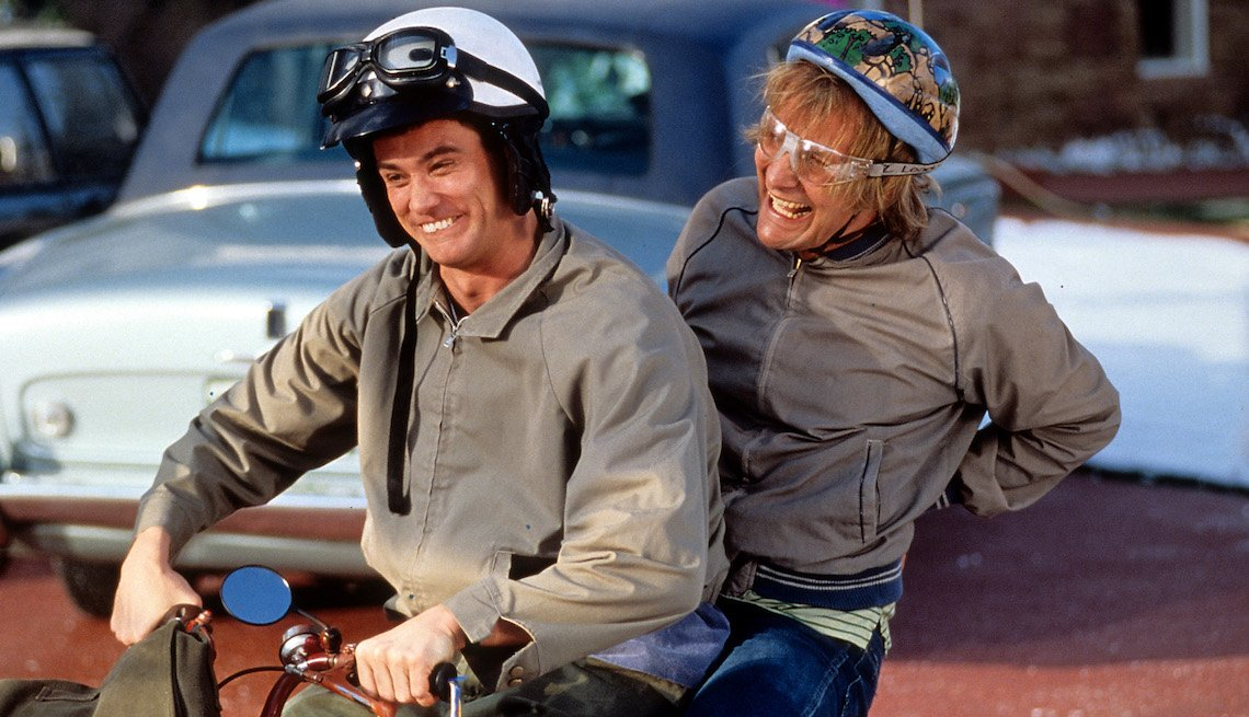 item 4, Gallery image. Jim Carrey and Jeff Daniels riding bike in a scene from the film 'Dumb & Dumber,' 1994.