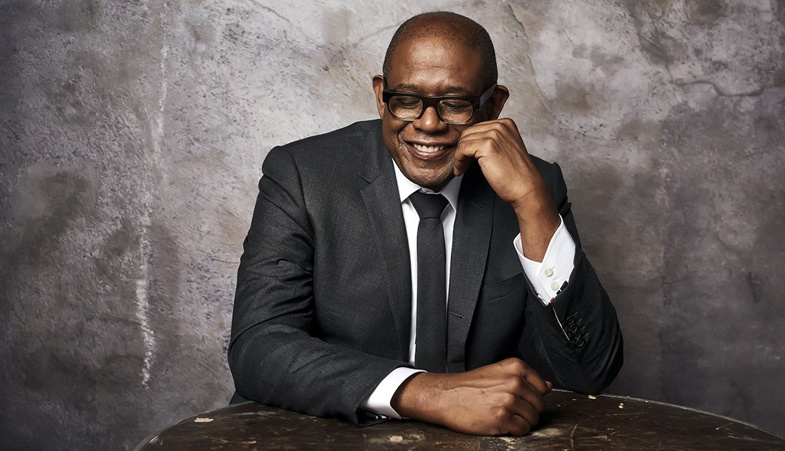 Actor Forest Whitaker in a black suit, black tie and white shirt