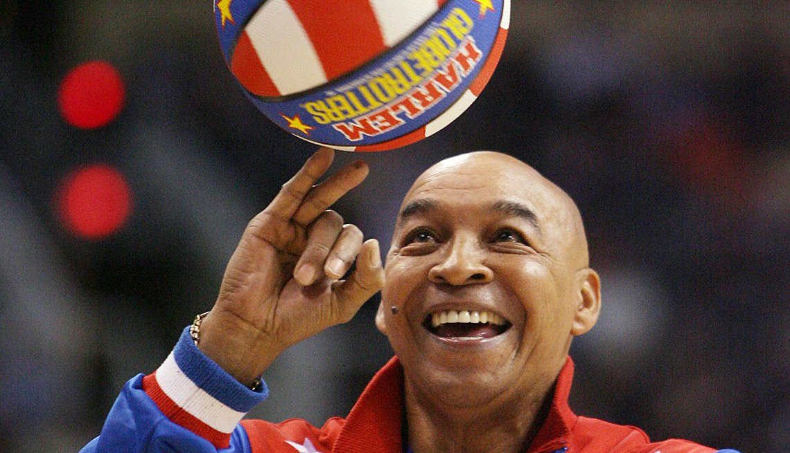 Fred Curly Neal of the Harlem Globetrotters performs during a timeout at an N B A basketball game between the Indiana Pacers and the Phoenix Suns