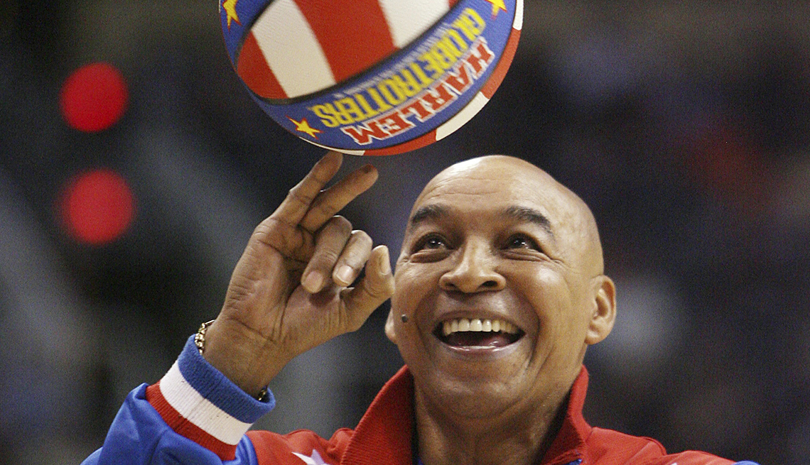 item 51 of Gallery image - Fred Curly Neal of the Harlem Globetrotters performs during a timeout at an N B A basketball game between the Indiana Pacers and the Phoenix Suns
