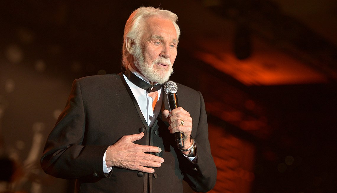 item 53 of Gallery image - Singer Kenny Rogers performs onstage during Muhammad Ali Celebrity Fight Night 20 held at the J W Marriott Desert Ridge Resort and Spa on April 12 2014 in Phoenix Arizona