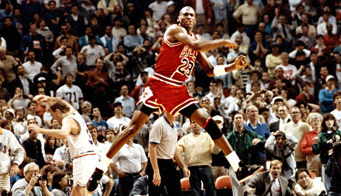 Michael Jordan of the Chicago Bulls jumps in celebration after making the game-winning shot over Cleveland's Craig Ehlo in Game 5 of the NBA playoffs on May 7 1989 in Cleveland Ohio