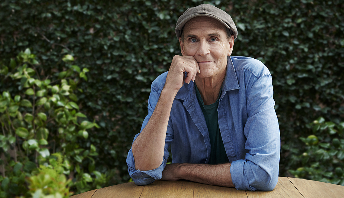 portrait of james taylor smiling sitting outdoors at a table