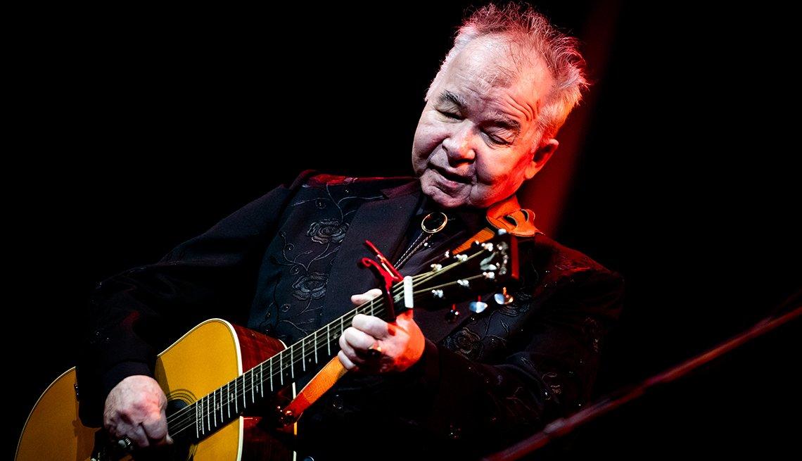 john prine performing on stage