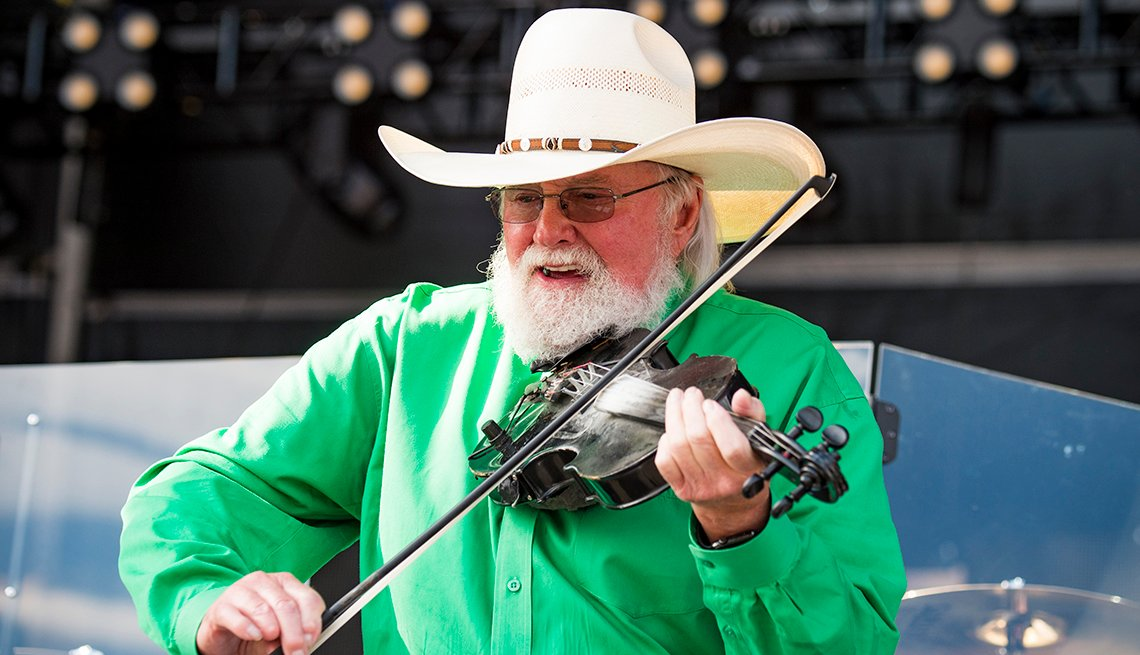 Charlie Daniels performs with his fiddle during the Faster Horses Festival in Michigan