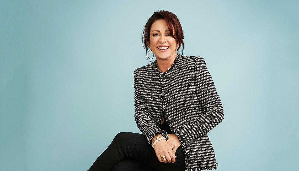 patricia heaton is smiling at the camera