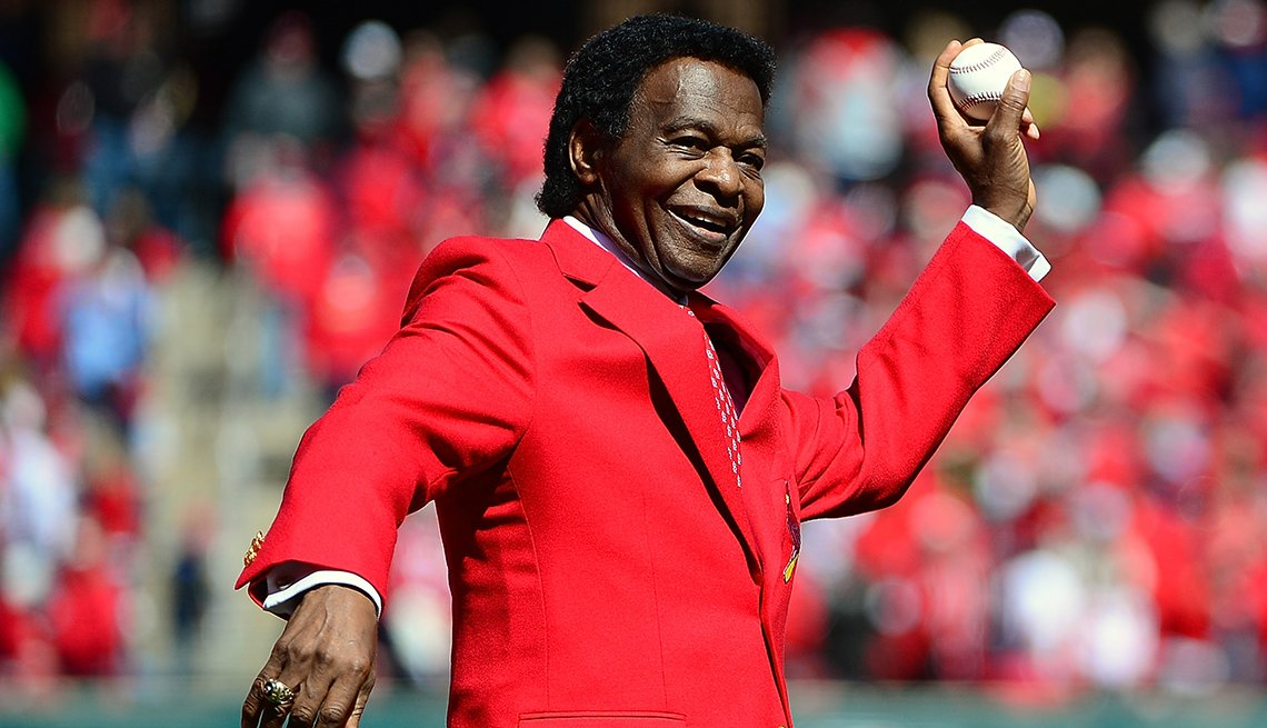 item 22 of Gallery image - Baseball Hall of Famer Lou Brock throws out the first pitch before the Saint Louis Cardinals home opener at Busch Stadium