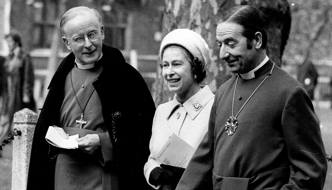item 8 of Gallery image - Queen Elizabeth II walking with Donald Coggan, Archbishop of Canterbury, and Stuart Blanche, Archbishop of York, from Westminster Abbey