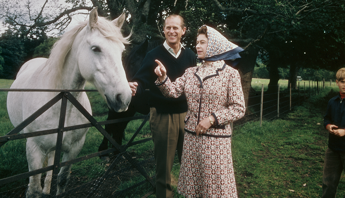 item 7 of Gallery image - Queen Elizabeth II and Prince Philip visit a farm on the Balmoral estate in Scotland in 1972