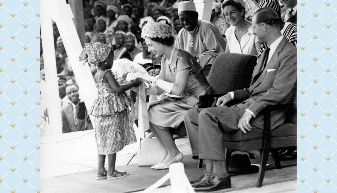 item 4 of Gallery image - Queen Elizabeth II receives a bouquet from a young girl during a Royal Tour of Sierra Leone in 1961