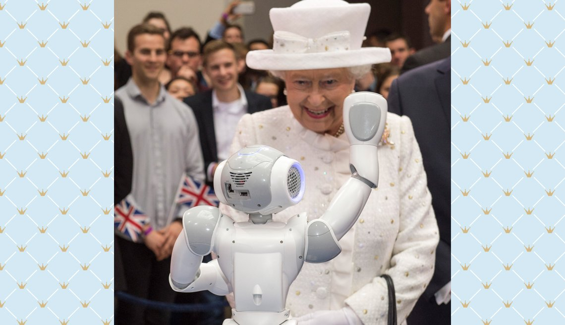 item 9 of Gallery image - Queen Elizabeth II watches a robot in action at Berlin's University of Technology during a 2015 state visit in Germany.