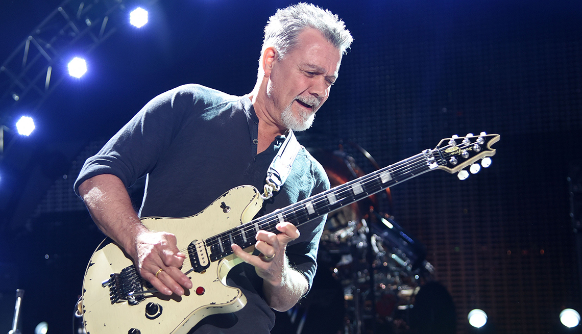 item 15 of Gallery image - Eddie Van Halen playing his guitar while performing at the Shoreline Amphitheatre in Mountain View, California