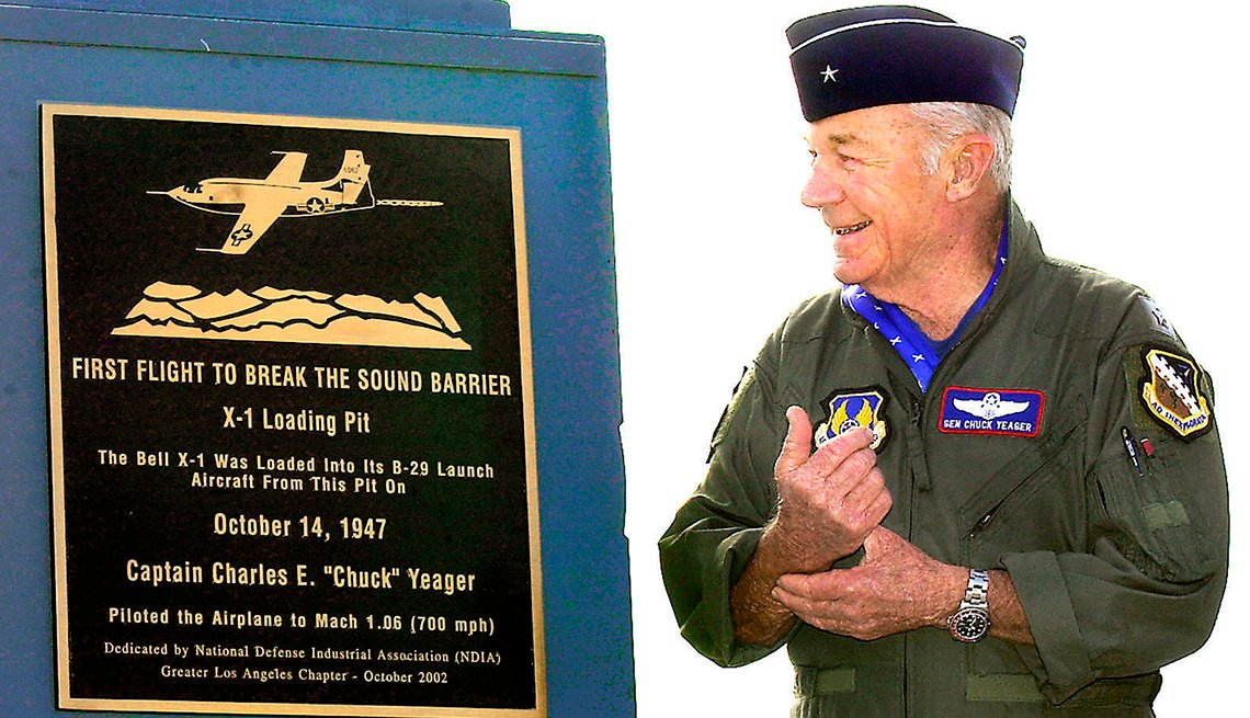 item 7 of Gallery image - Retired Air Force Brig. Gen. Chuck Yeager receives a plaque from the National Defense Industrial Association, recognizing his breaking of the sound barrier and the use of X- 1 loading pit, at Edwards Air Force Base in California