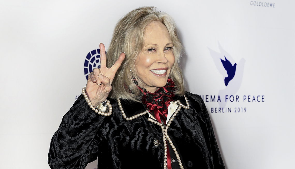 item 6 of Gallery image - actor faye dunaway gives us a peace sign at a premiere event