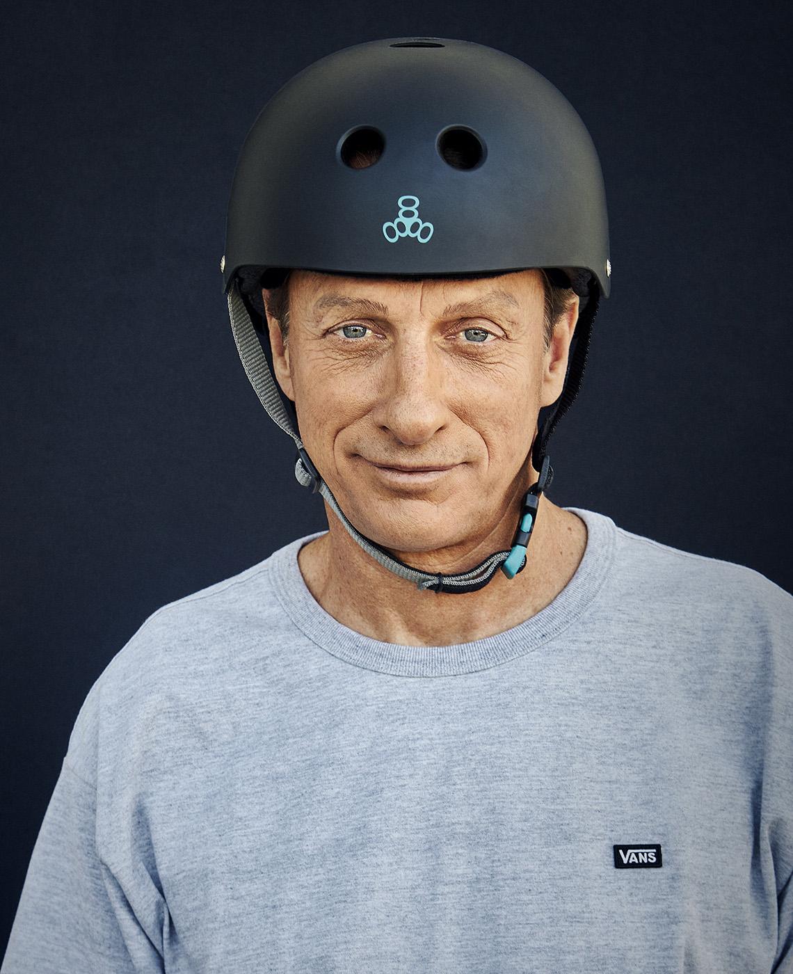 A close-up of skateboarding legend Tony Hawk wearing a helmet