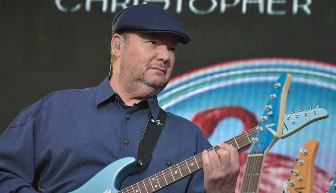 item 1 of Gallery image - Musician Christopher Cross playing his guitar