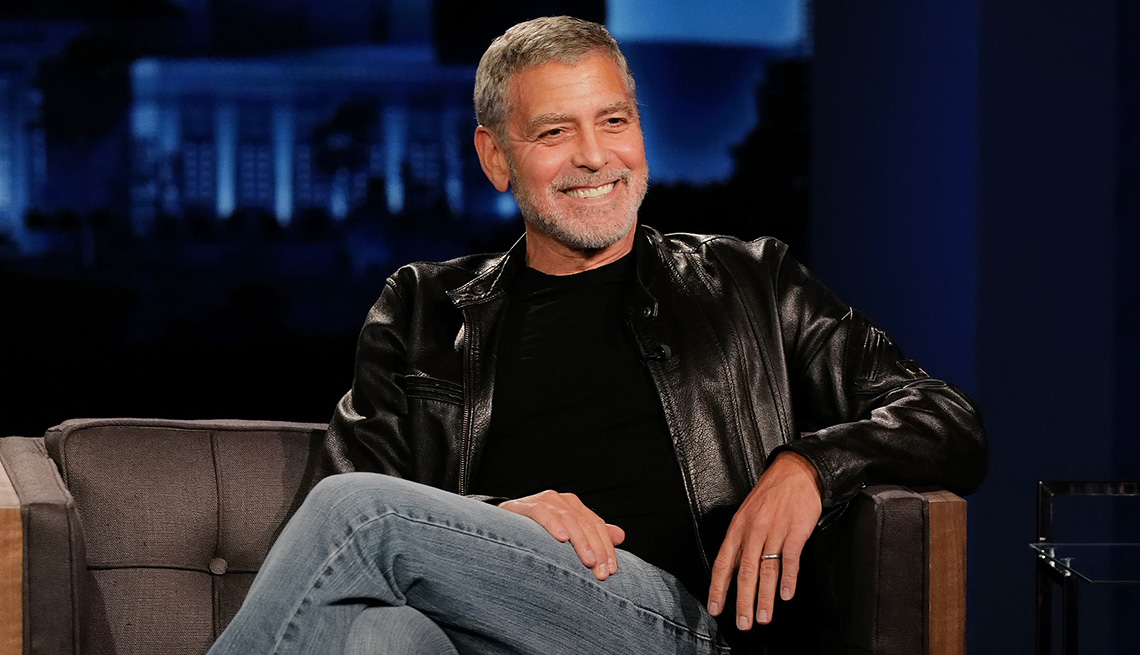 item 2 of Gallery image - George Clooney sits in a chair for an interview on Jimmy Kimmel Live