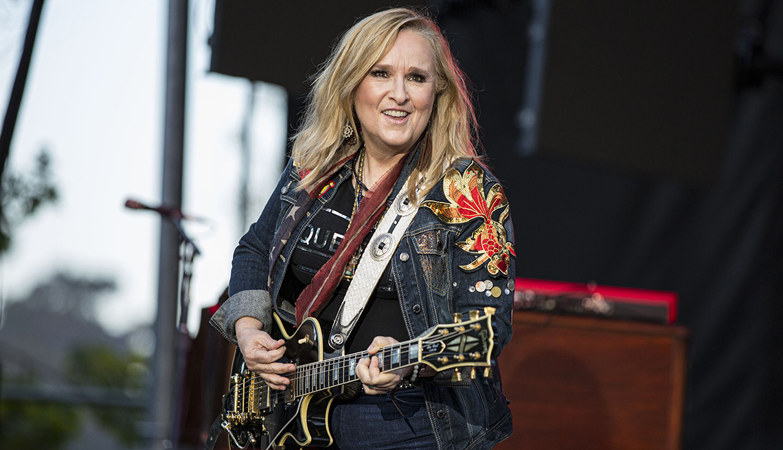 item 9 of Gallery image - Musician Melissa Etheridge playing her guitar onstage at the San Diego Pride Festival