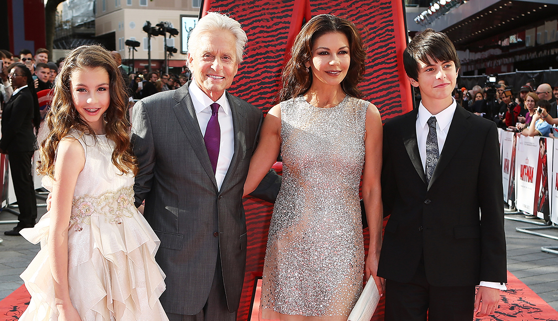 actors michael douglas and catherine zeta jones pose at a red carpet event with their children