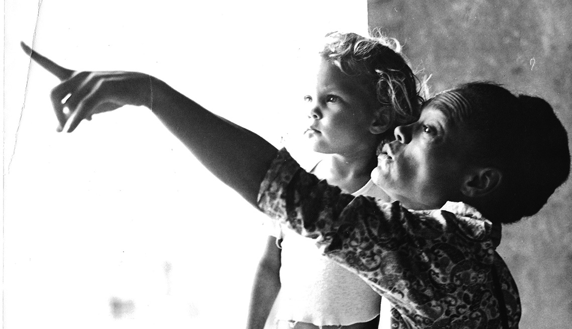 A black and white photo of Kitt Shapiro as a child with her mother Eartha Kitt