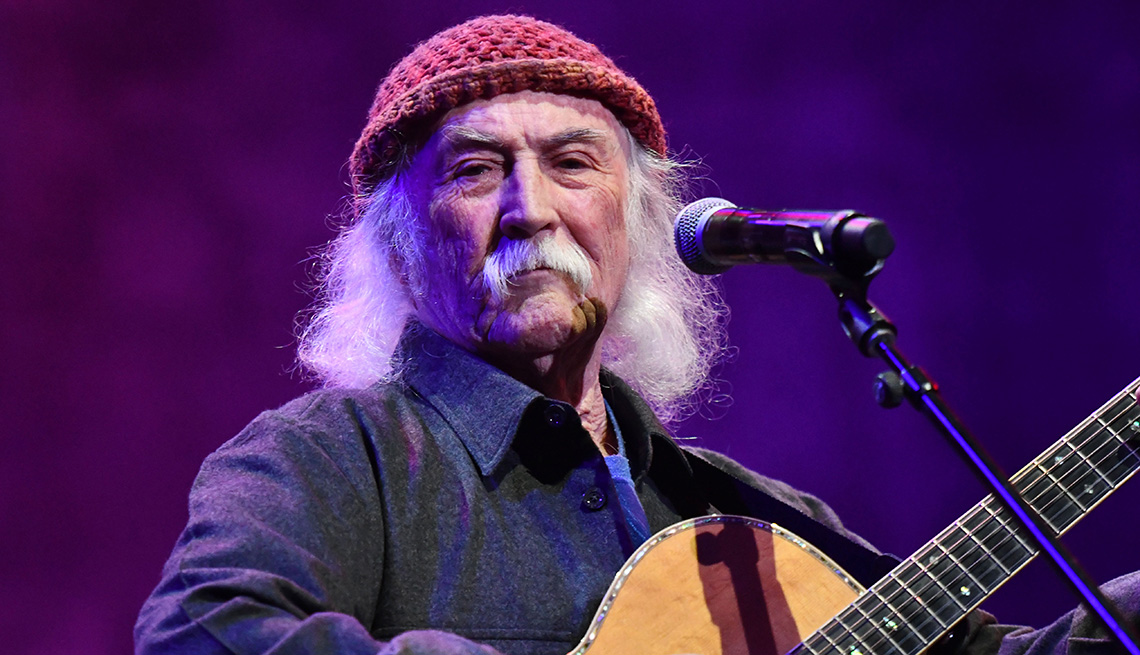 item 6 of Gallery image - David Crosby playing his guitar onstage
