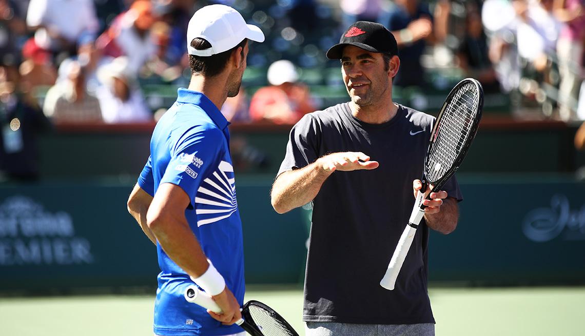 item 5 of Gallery image - Pete Sampras talks to Novak Djokovic on the tennis court during an exhibition match