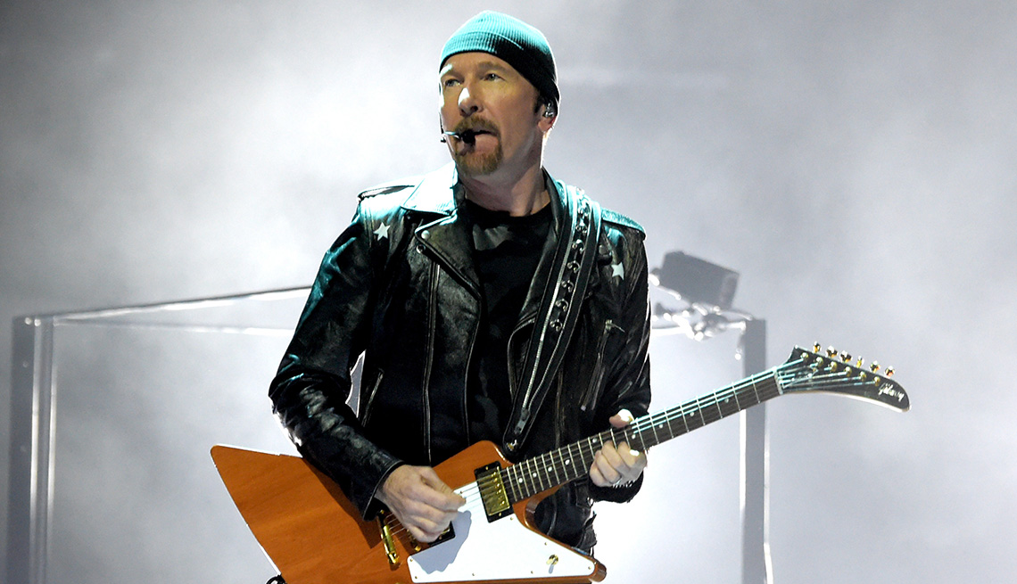 item 4 of Gallery image - The Edge of the band U2 playing his guitar onstage