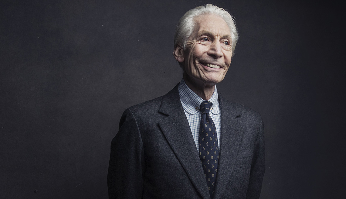 item 7 of Gallery image - Rolling Stones drummer Charlie Watts smiles for portrait