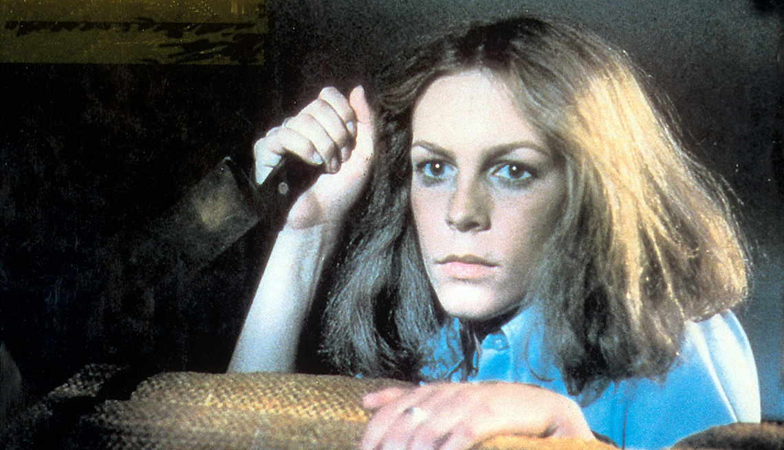 Jamie Lee Curtis holds a knife in a scene from the film Halloween