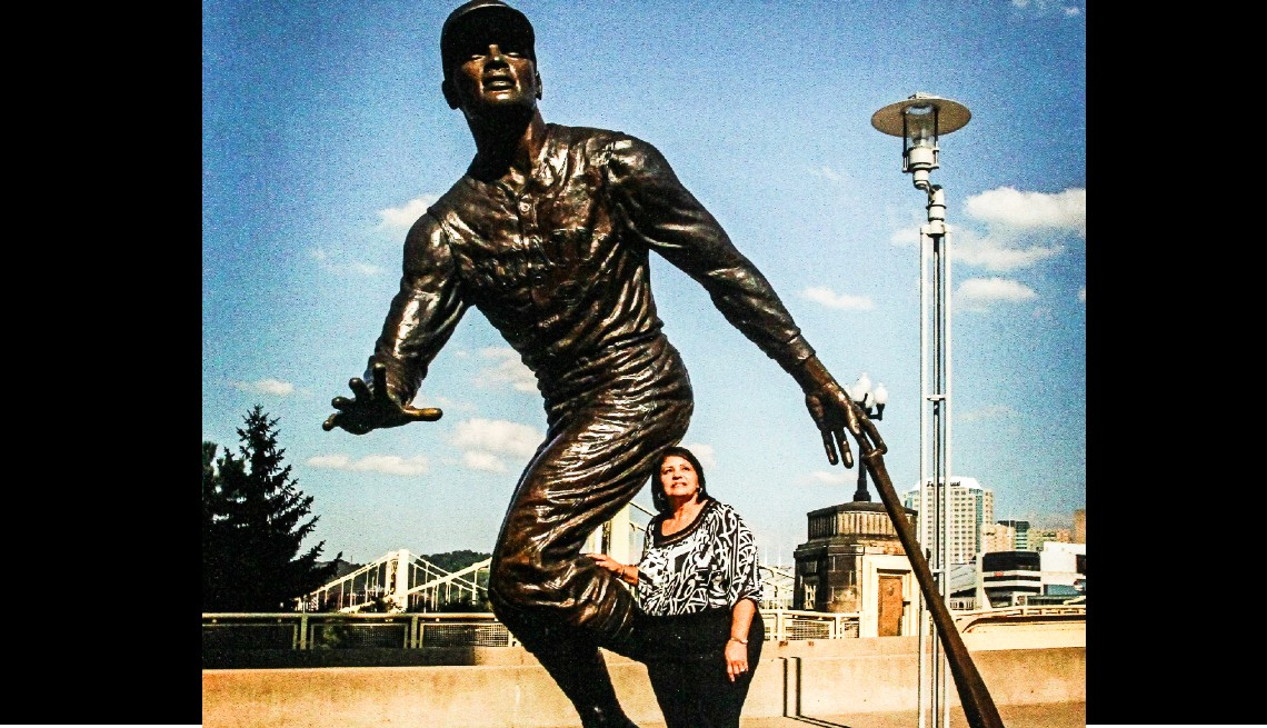 item 9 of Gallery image - Vera Clemente stands in front of the bronze statue of her late husband Roberto at PNC Park in Pittsburgh