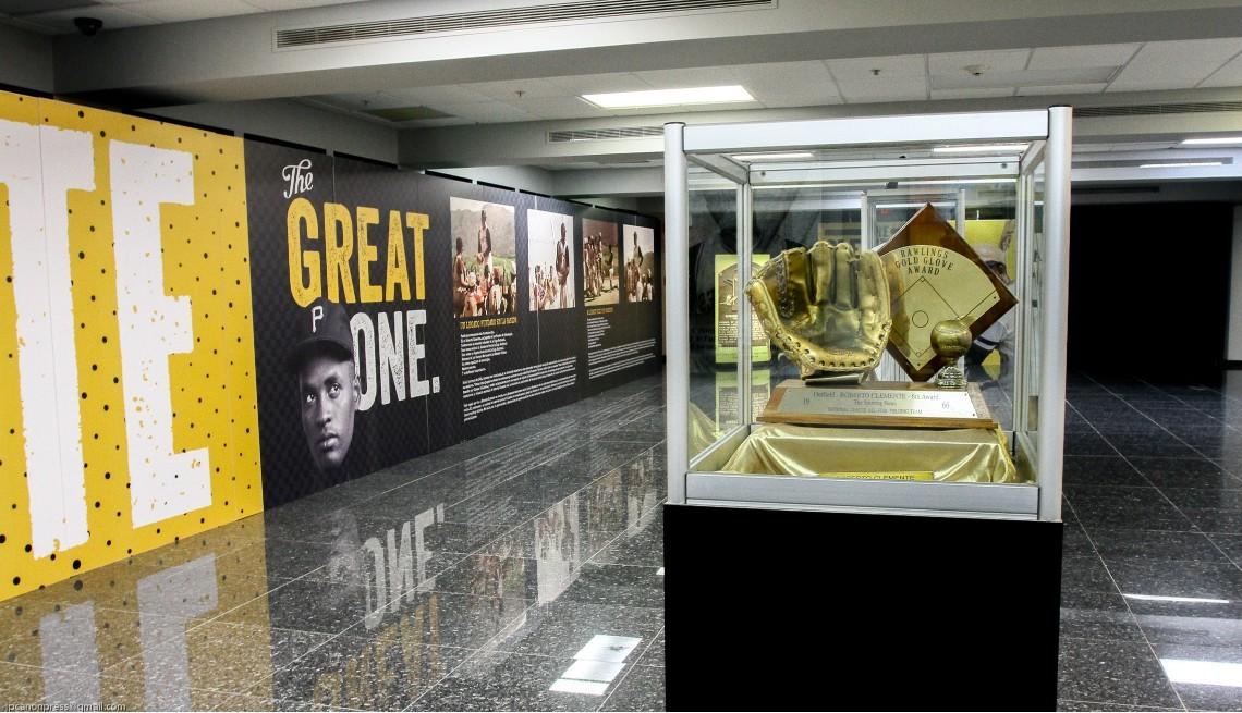 item 8 of Gallery image - The last of Roberto Clemente's 12 Gold Gloves on display at El Museo del Deporte de Puerto Rico