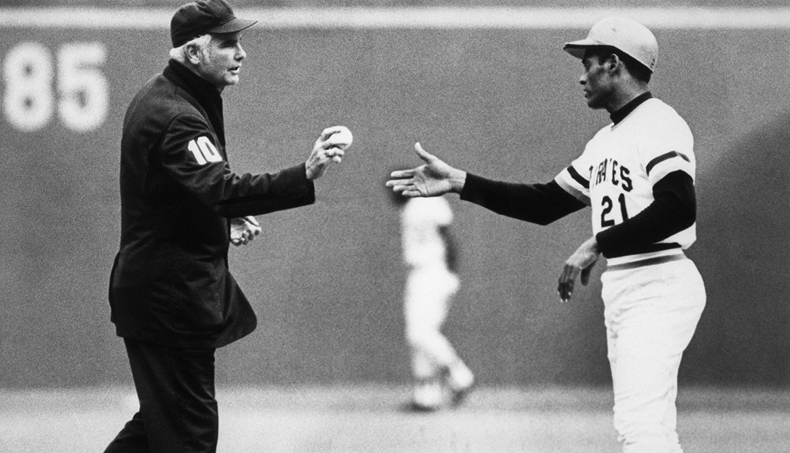 item 3 of Gallery image - Roberto Clemente receives the ball from the umpire after his 3000th career Major League Baseball hit