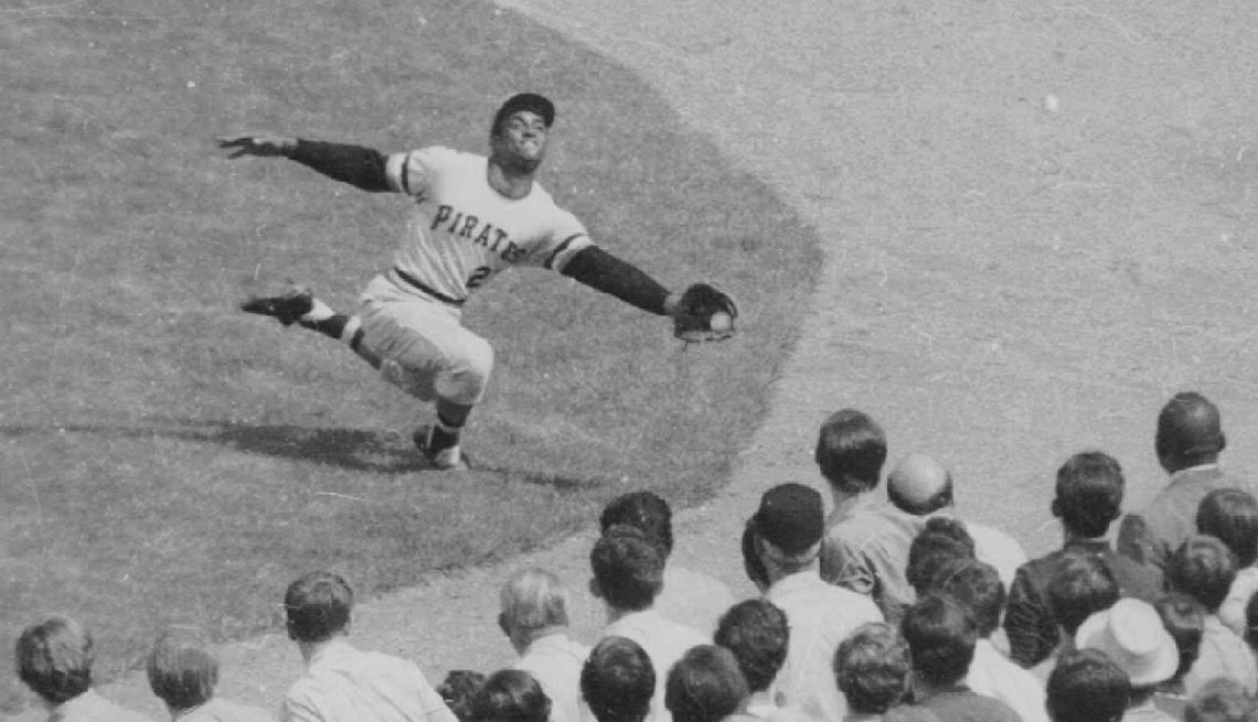 item 4 of Gallery image - Roberto Clemente makes a lunging catch in right field during a game against the New York Mets in 1970