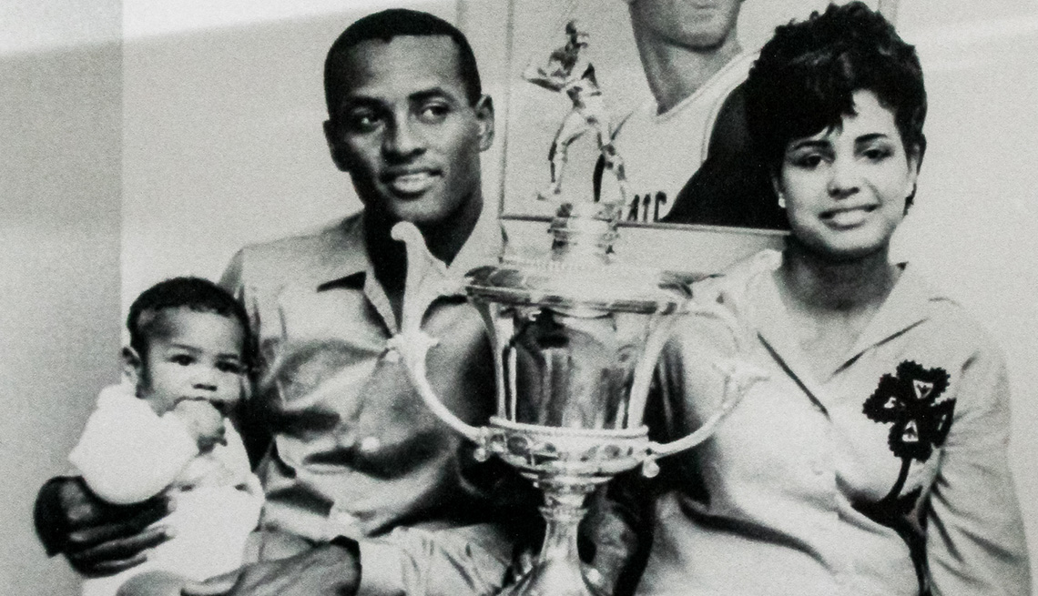 item 7 of Gallery image - Roberto Clemente with his wife, infant son and a trophy from a Puerto Rican baseball league