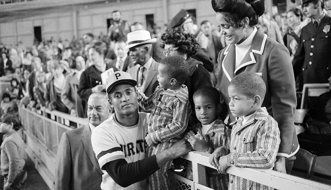 item 5 of Gallery image - Roberto Clemente with his wife and three sons at Shea Stadium in New York